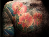 Orchid chest piece tattoo