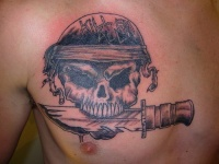 Skull with knife chest piece tattoo picture